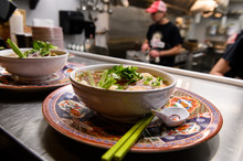 Two Bowls Of Pho Soup Ready To...