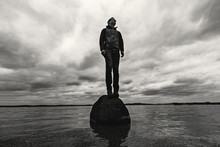 Man Stands On Rock In Middle O...