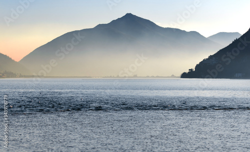 Lake of Lugano in a foggy day during sunset with a mountain in the background Canvas Print