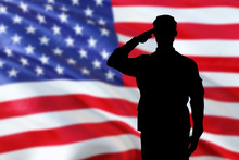 Soldiers Silhouette Saluting The USA Flag For Memorial Day Or Veterans Day