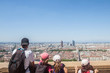 Family observing an Aerial panoramic view of Lyon with the skyline and the the major districts of the city visible. Lyon is the second biggest city of France and a major touristic destination
