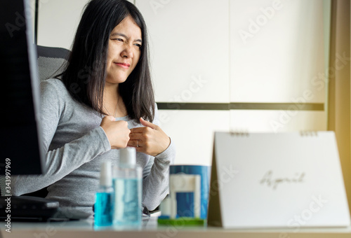 Asian woman having or symptomatic reflux acids during working at home Canvas Print