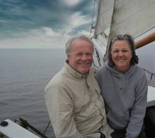 A  Couple Enjoying A Calm Sail Off The Maine Coast.