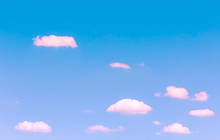 Small Pink Clouds Floating On Blue Sky With Day Light