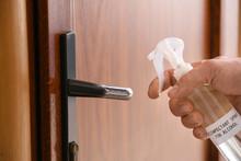 Man Disinfecting Door Handle, ...