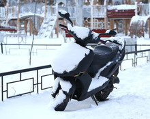 Covered In White Snow Black Moped