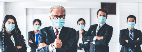 Fototapeta Confident business people with face mask protect from Coronavirus or COVID-19. obraz