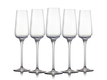 Set Of Empty Champagne Glasses In A Row Isolated On A Black Background