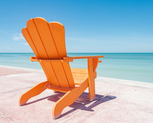Orange Adirondack Chair With Tropical View
