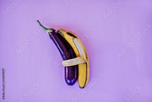 Banana hugs an eggplant with peel. Slika na platnu