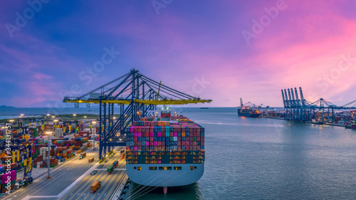 Obraz na plátně Container cargo ship at industry sea port, import export commerce global business trade logistic and transportation oversea worldwide by container cargo vessel ship boat, Freight shipping maritime