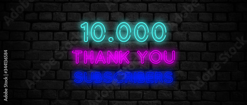 10000 subscribers neon sign on the black wall. Slika na platnu