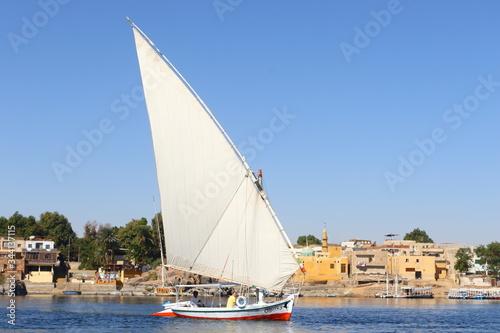 Traditional felucca sailing boat crossing Nile river at Aswan Canvas Print