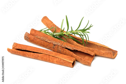 Fotografie, Obraz Cinnamon and rosemary on a white background