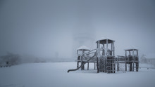 Jungle Gym On Snow Covered Park Against Sky