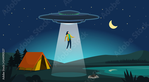 Photo Alien abduction: ufo kidnapping a woman at night