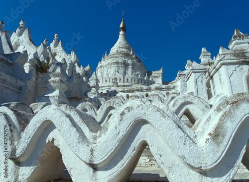 Fotografie, Obraz Selective focus of the white Hsinbyume Pagoda or Mya Thein Dan pagoda in Mingun, Myanmar, with blue sky