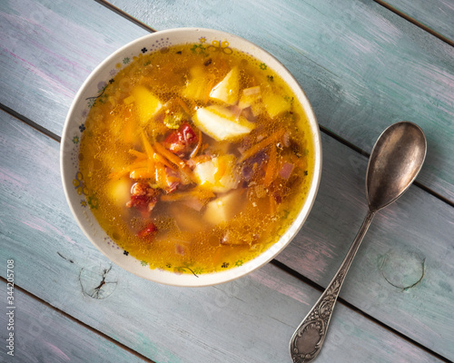Homemade freshly prepared soup with smoked pork ribs in a deep plate and a table Tapéta, Fotótapéta