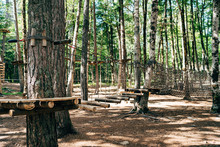 Climbing Park High In The Trees. Obstacle Course In Amusement Park. Outdoor Sports Activity. Challenge Adventure Solo Sport. High Ropes Element In The Woods.