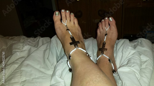 Photo Low Section Of Woman Wearing Anklet At Home