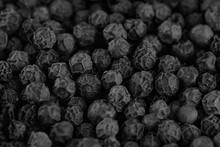 Black Peppers Peas Background