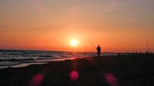 Fisherman Fishes In A Beautifu...