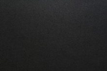 黒い厚紙の表面のテク...