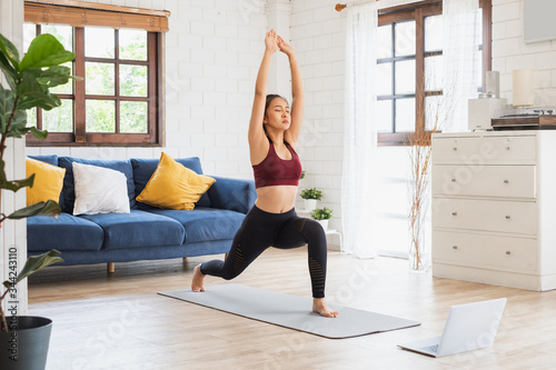 Cuadros en Lienzo Young Asian healthy woman workout at home, exercise, fit, doing yoga, home fitne