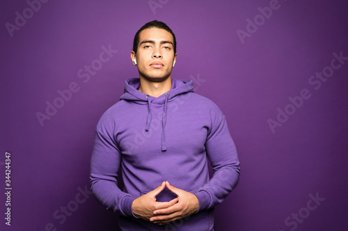 Portrait of young beautiful serious man standing with his hands over his chest Slika na platnu