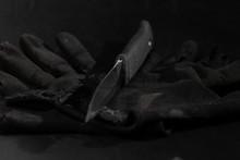 Combat Knife On An Old Black G...