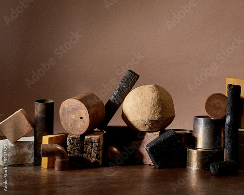 Still life with pieces of wood and concrete pipes - 344252116