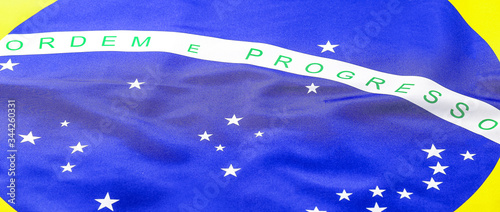 Fototapeta details of the flag of brazil, fabric flag macro photo. Concept of patriotism, beloved homeland brazil. obraz