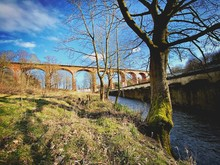 A Scenic View Of Chester Burn Railway Viaduct. Tall Red Brick Arches Cross Cong Burn Stream In A Small Town In The North East Of England. Built In 1868. Chester Le Street, County Durham, UK.