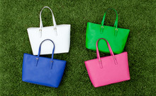 Colorful Tote Bags On Green Gr...