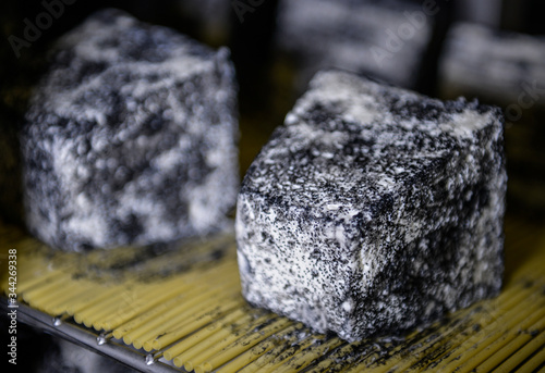 well ripened goat and ewe cheeses in cellar ripening  with grey and white mould Fototapet