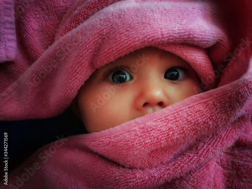 Fotografie, Obraz Close-up Portrait Of Cute Baby Girl Wrapped In Towel