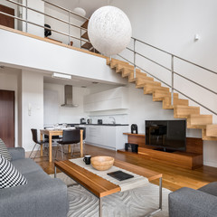 Modern apartment with wooden stairs