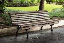 Empty Wooden Bench In Park