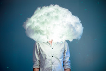 Young Man With Head In The Clouds
