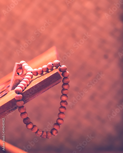 Prayer beads on wooden book stand, vertical view 4:5 aspect ratio Canvas Print