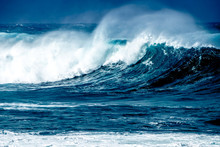 Scenic View Of Waves Splashing In Sea Against Sky