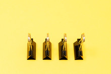 High Angle View Of Binder Clips On Yellow Background