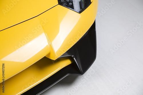 Fototapeta Closeup shot of the exterior details of a modern yellow sport car obraz