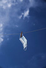 Surgical Mask Hanging On A Lau...