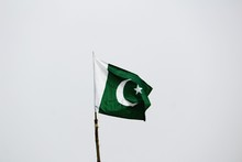 Low Angle View Of Pakistani Flag Against Gray Background