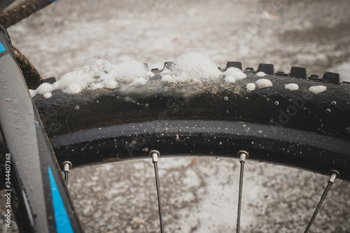 Perforated or punctured mountain bicycle tire, with visible foam escaping through perforated holes Canvas Print