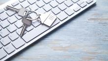 House Keys On The Computer Key...