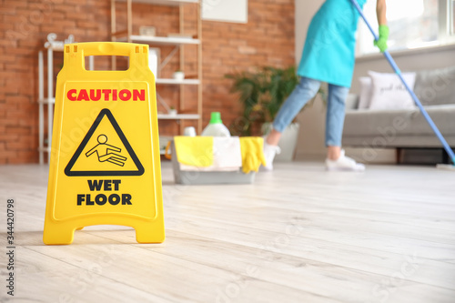 Fotomural Caution sign with text WET FLOOR in room
