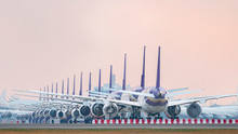 Aircraft Parking At Airport Runway Because Of COVID-19 Pandemic Outbreak Make Airline Stop Operation.