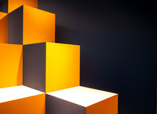 Close-up Of Yellow Cubes Against Black Background